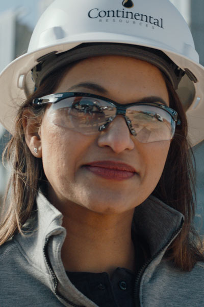 Female worker in hard hat and goggles